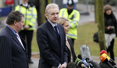 ** FILE ** WikiLeaks founder Julian Assange (center) speaks to the media flanked by his lawyers, Mark Stephens (left) and Jennifer Robinson, after making a appearance at Belmarsh Magistrates' Court in London on Tuesday, Jan. 11, 2011. (AP Photo/Matt Dunham)