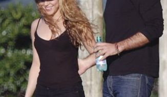 """FILE- In this Dec. 18, 2008 file photo, Colombian pop singer Shakira, left, walks with her boyfriend Argentina's Antonio de la Rua at her farm """"La Colorada"""" in Jose Ignacio, some 190 kilometers east of Montevideo, Uruguay. Shakira and her Argentine boyfriend of 11 years say in a note on the Colombian pop star's website that they have split up. Shakira and de la Rua say they decided in August to """"take time apart"""" from their romantic relationship but kept the details private until now. (AP Photo/File)"""