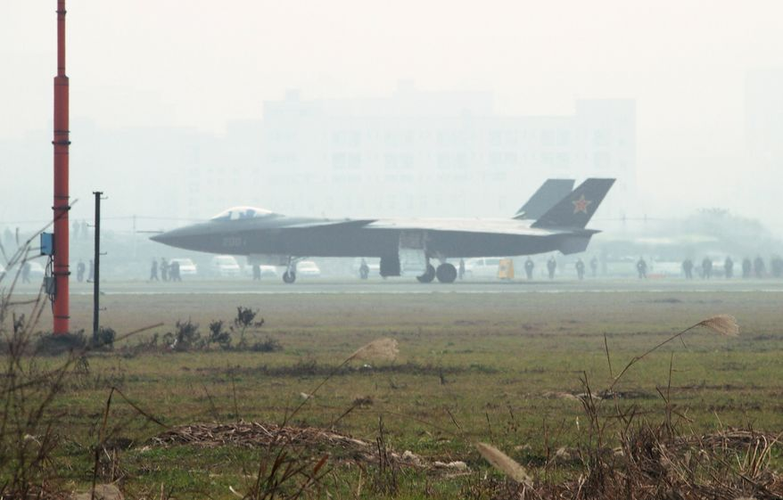 In this Friday Jan. 7, 2011, photo, a prototype of the Chinese J-20 stealth plane is seen during a runway test in Chengdu, southwest China. The plane made its first test flight Tuesday, Jan. 11, 2011. (AP Photo/Kyodo News)