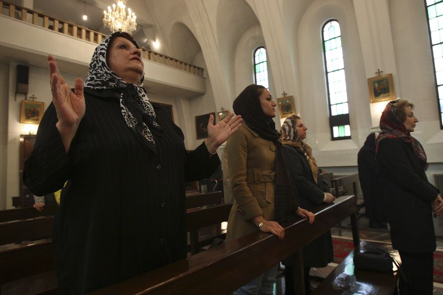 ** FILE ** Iranian Christians attend Christmas Mass at St. Grigor Armenian Catholic Church in Tehran on Saturday, Dec. 25, 2010. Iran has arrested about 70 Christians since Christmas in a crackdown that demonstrates the limits of religious tolerance by Islamic leaders, who often boast they provide room for other faiths. (AP Photo/Vahid Salemi)