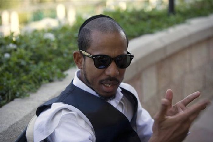 "FILE - In this Thursday, Nov. 11, 2010 file photo, U.S. rapper Jamal ""Shyne"" Barrow gestures during an interview with The Associated Press in Jerusalem. Reformed rapper and ex-convict Shyne said Tuesday, Jan. 11, 2011 that he is eager to collaborate with artists ranging from young Israeli musicians to hip hop moguls Kanye West and Jay-Z as he revives his career. (AP Photo/Tara Todras-Whitehill, File)"