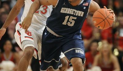 Former Georgetown basketball standout Austin Freeman faces seven traffic offenses, including driving under the influence of alcohol, from an incident less than 48 hours after he wasn't picked in the NBA draft, according to Hyattsville District Court records. (AP Photo/Henny Ray Abrams, File)