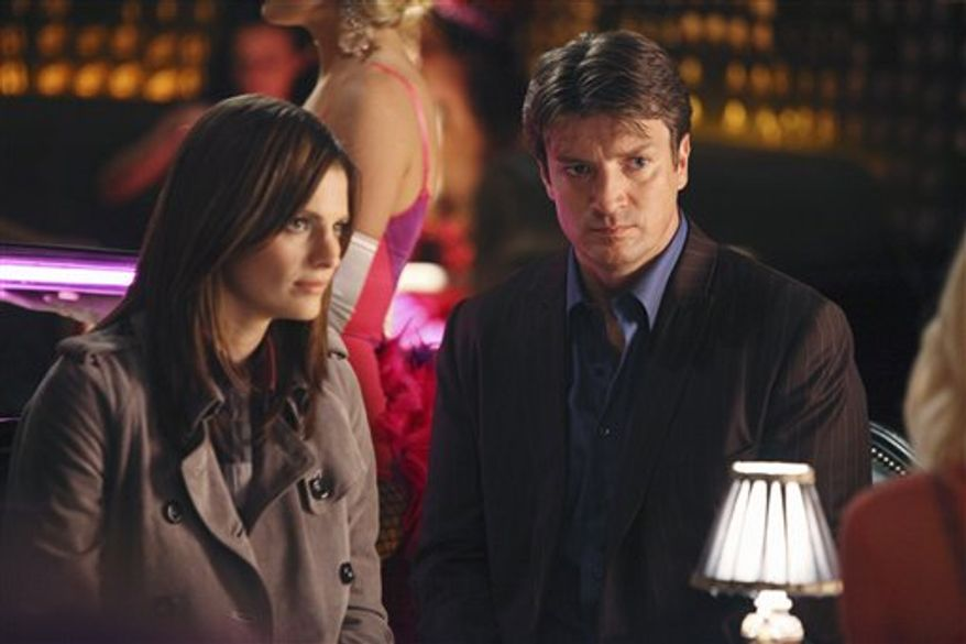 "In this undated publicity image released by ABC, Stana Katic, left, and Nathan Fillion are shown in a scene from ""Castle."" (AP Photo/ABC, Adam Larkey)"