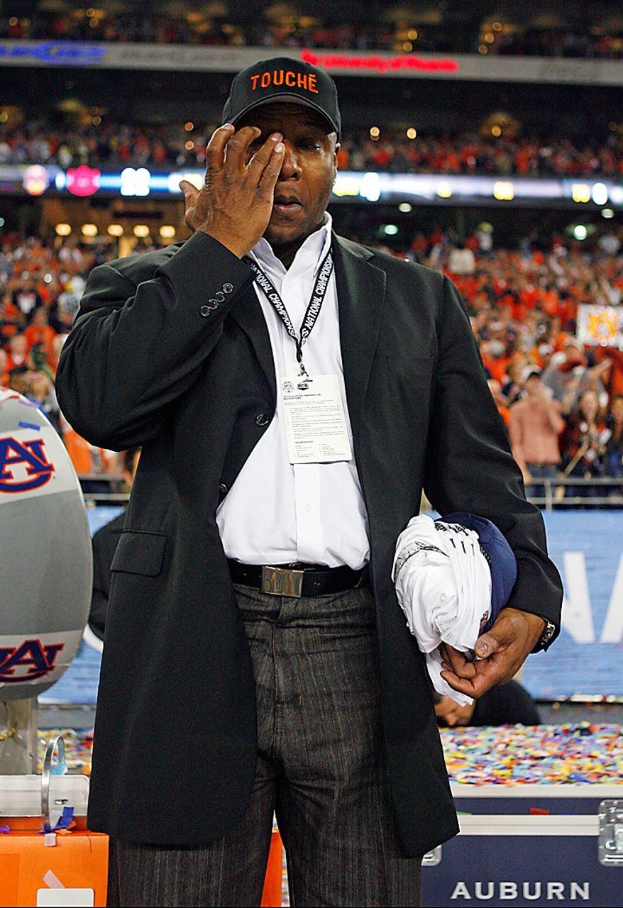Former Auburn player Bo Jackson wipes a tear from his eye after the BCS championship NCAA college football game on Monday, Jan. 10, 2011, in Glendale, Ariz. Auburn defeated Oregon, 22-19. (AP Photo/The Arizona Republic, David Kadlubowski)