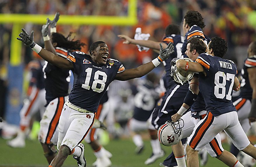 Auburn's Kodi Burns (18) and teammates celebrate after beating Oregon 22-19 in the BCS national championship NCAA college football game on Monday, Jan. 10, 2011, in Glendale, Ariz. (AP Photo/Chris Carlson)