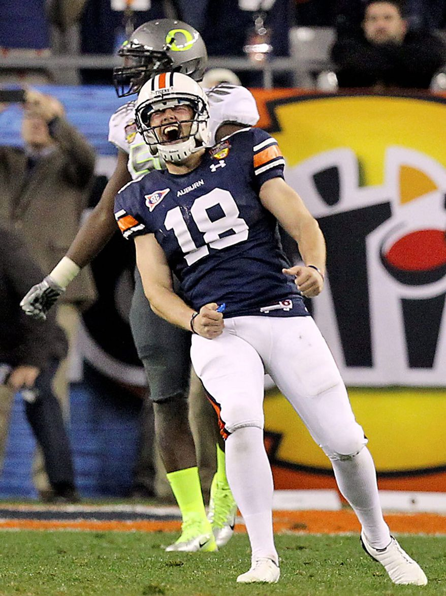 Auburn's Wes Byrum (18) reacts after kicking the game-winning field goal in the closing seconds of the second half of the BCS national championship NCAA college football game on Monday, Jan. 10, 2011, in Glendale, Ariz. Auburn won, 22-19.(AP Photo/Chris Carlson)
