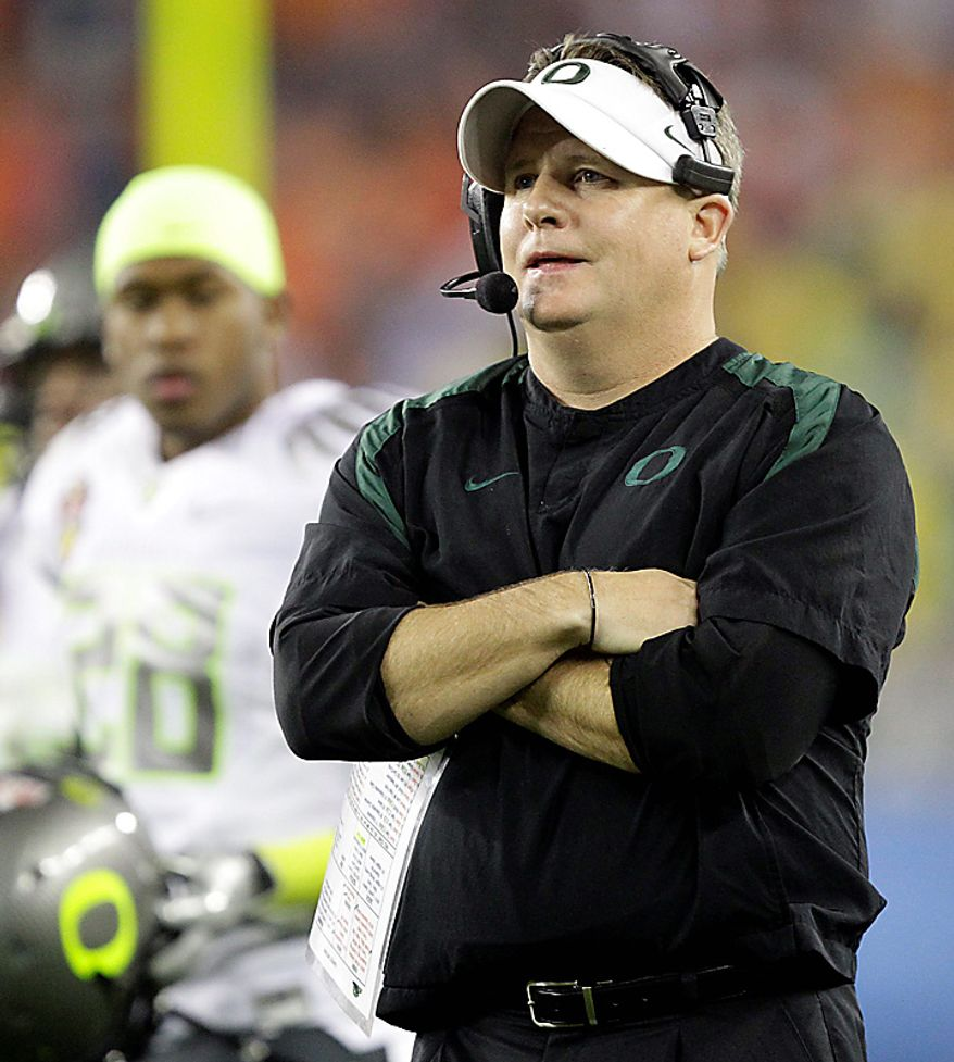 Oregon head coach Chip Kelly looks on during the first half of the BCS national championship NCAA college football game against Auburn on Monday, Jan. 10, 2011, in Glendale, Ariz. (AP Photo/Matt York)