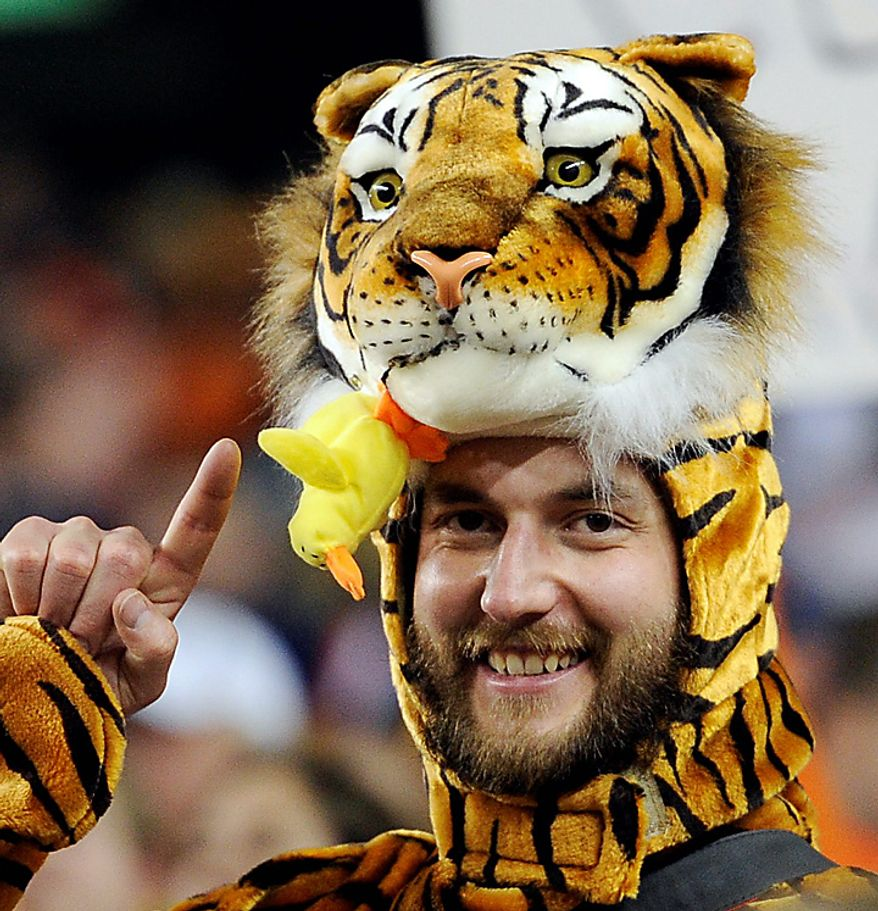 Blake Beyea of Denver cheers before the BCS national championship NCAA college football game between Auburn and Oregon at the University of Phoenix Stadium on Monday, Jan. 10, 2011, in Glendale, Ariz. (AP Photo/Mark J. Terrill)