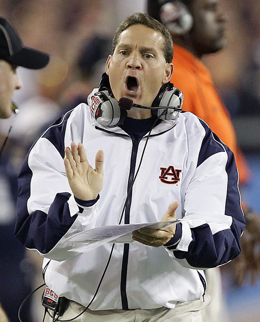 Auburn head coach Gene Chizik urges his team on during the second half of the BCS national championship NCAA college football game against Oregon on Monday, Jan. 10, 2011, in Glendale, Ariz. (AP Photo/Matt York)