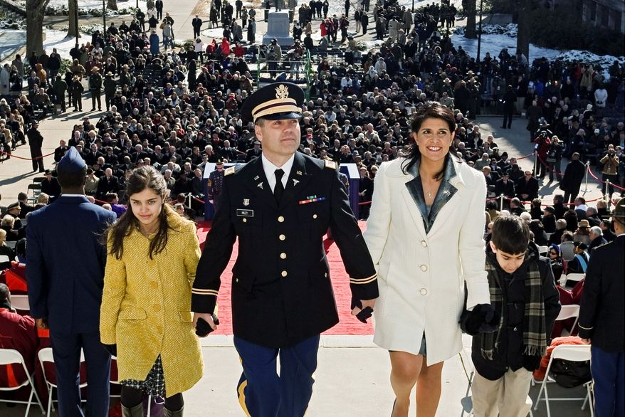 South Carolina Gov. Nikki Haley makes her way into the Statehouse with her husband, Michael Haley, her daughter, Rena, and her son, Nalin, after taking the oath of office in the state capital, Columbia. She is the first woman and the first member of a minority to be the state's chief executive. (Associated Press)