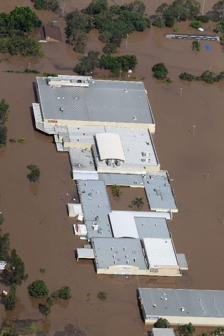 An entire shopping mall is submerged outside Ipswich, west of Brisbane, Australia. (Associated Press)