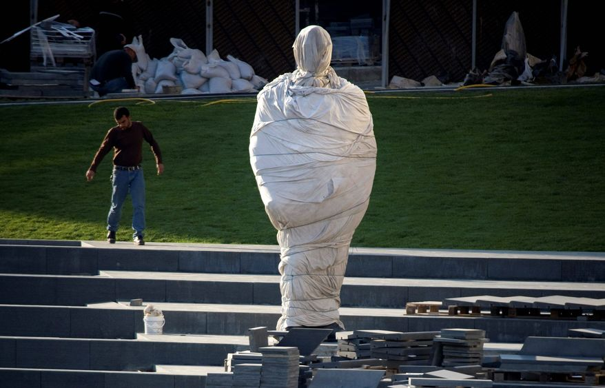 A covered statue of slain Lebanese Prime Minister Rafik Hariri stands in Beirut. Eleven of 30 Lebanese Cabinet members, all supporters of Hezbollah, resigned Wednesday, sinking the coalition government after months of disagreement over how to respond to a U.N. probe into the assassination. (Associated Press)