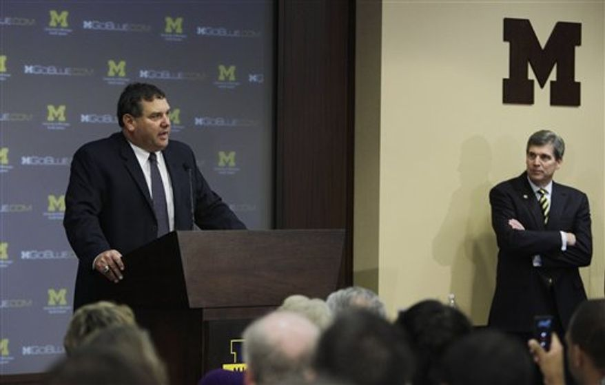 University of Michigan head football coach Brady Hoke addresses the media during a news conference in Ann Arbor, Mich., Wednesday, Jan. 12, 2011. Hoke becomes the 19th coach in the 131-year history of Michigan football and arrives in Ann Arbor after spending the past eight seasons as a head coach at Ball State and San Diego State. (AP Photo/Carlos Osorio)