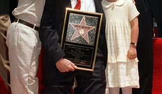 "Actor and director David Nelson poses with grandson Michael Woolery and family friend Ashley Holt in 1996 as he is honored with a Hollywood Walk of Fame star. He became famous on ""The Adventures of Ozzie & Harriet"" TV show. (Associated Press)"