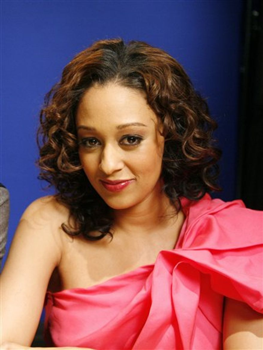 In this Jan. 10, 2011 photo, actress Tia Mowry pose for a portrait in New York.  (AP Photo/Jeff Christensen)