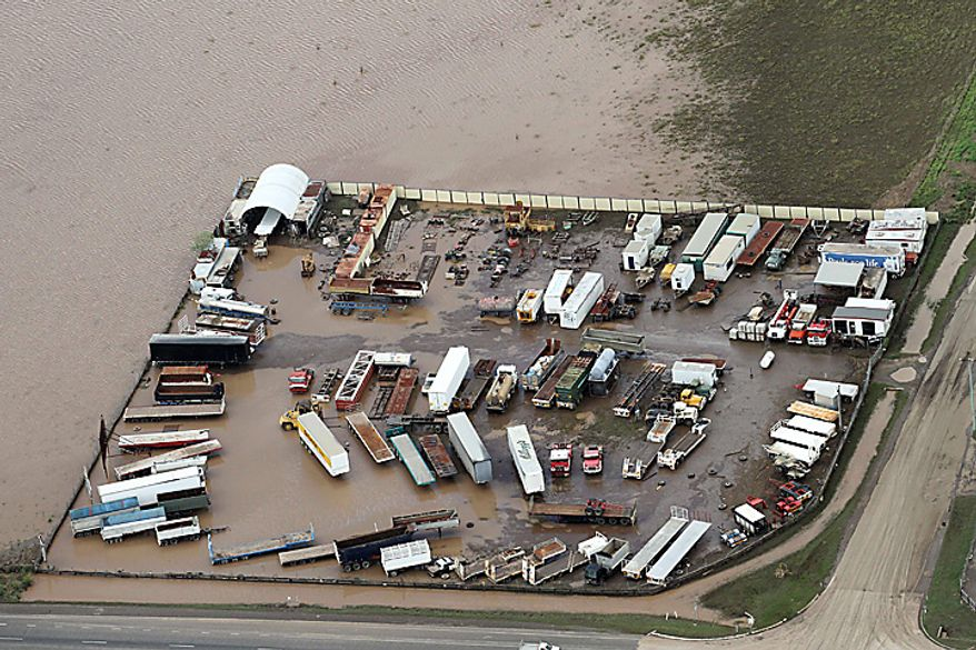 An entire small industry is submerged outside Ipswich, west of Brisbane, Australia, Wednesday, Jan. 12, 2011. Emergency sirens blared across Australia's third-largest city Wednesday as floodwaters that have torn a deadly path across the northeast poured into an empty downtown, swamping neighborhoods in what may be Brisbane's worst flooding in 100 years. (AP Photo)