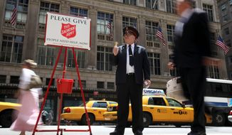 "Salvation Army ""soldier"" Daniel Aherns collects donations on Fifth Avenue at Rockefeller Center in New York in 2011. (Associated Press)"