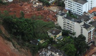Homes affected by landslides in the Nova Friburgo municipality of Rio de Janeiro state in Brazil are seen on Thursday in this photo released by Rio de Janeiro's state government. At least 355 people died in Rio state towns after slides hit early Wednesday, and at least 50 people were still missing, officials said. (Associated Press)
