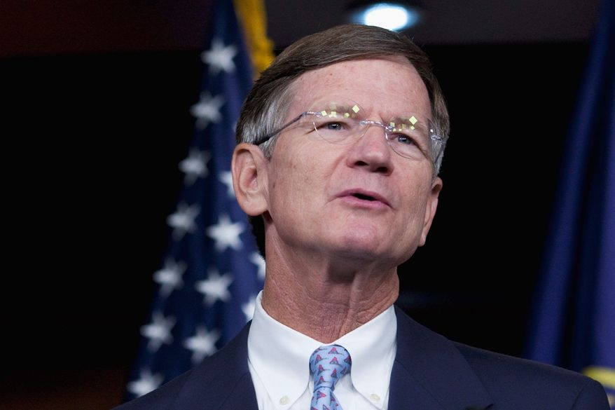 """Rep. Lamar Smith says both sides are """"big boys"""" who didn't need Congress to """"referee every business dispute."""" (Associated Press)"""