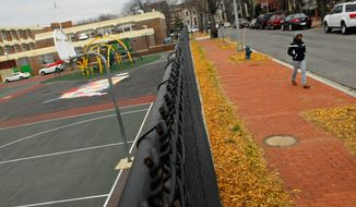 Ludlow Taylor Elementary School, about eight blocks from Union Station in Washington, is where hit man Oscar Veal stalked Roy Cobb on May 14, 1998, but opted not to kill him in front of his girlfriend's children. He admitted in court testimony to murdering Cobb weeks later. (J.M. Eddins/The Washington Times)