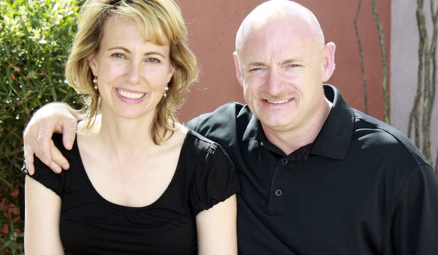 **FILE** Rep. Gabrielle Giffords, Arizona Democrat, is shown with her husband, Navy Capt. Mark Kelly, who is a NASA astronaut. (Associated Press/Office of Rep. Gabrielle Giffords)