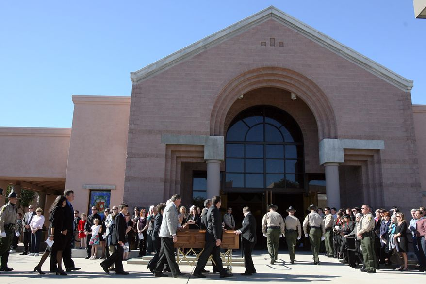 Pall bearers bring in the casket at the St. Elizabeth Ann Seton Church for the funeral of 9-year-old Christina Green Thursday, Jan. 13, 2011, in Tucson, Ariz. Christina was the youngest victim of Saturday's shooting in Tucson. (AP Photo/Mamta Popat, Pool)