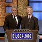 "** FILE ** In this July 13, 2004, file photo provided by Sony Pictures Television, software developer Ken Jennings from Salt Lake City, Utah, right, poses for a photo with Jeopardy host Alex Trebek on the set of the show in Culver City, Calif. On Thursday, Jan. 13, 2011, the IBM hardware and software system named Watson was to play a practice round against Ken Jennings, who won a record 74 consecutive ""Jeopardy!"" games in 2004-05, and Brad Rutter, who won a record $3,255,102 in prize money. (AP Photo/Sony Pictures Television, File)"