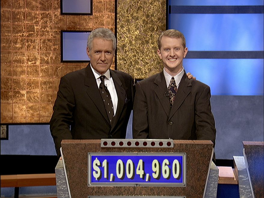 """** FILE ** In this July 13, 2004, file photo provided by Sony Pictures Television, software developer Ken Jennings from Salt Lake City, Utah, right, poses for a photo with Jeopardy host Alex Trebek on the set of the show in Culver City, Calif. On Thursday, Jan. 13, 2011, the IBM hardware and software system named Watson was to play a practice round against Ken Jennings, who won a record 74 consecutive """"Jeopardy!"""" games in 2004-05, and Brad Rutter, who won a record $3,255,102 in prize money. (AP Photo/Sony Pictures Television, File)"""