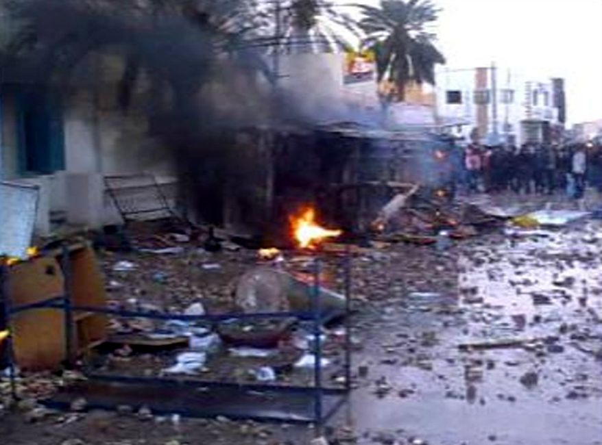 In this frame-grab image taken from amateur video acquired by Associated Press Television News, protesters are seen amid a burning vehicle in Douz, Tunisia, on Wednesday Jan. 12, 2011. (AP Photo)