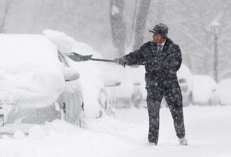 Jim Schumacher shovels snow near his vehicle in Albany, N.Y., on Wednesday, Jan. 12, 2011. (AP Photo/Mike Groll)