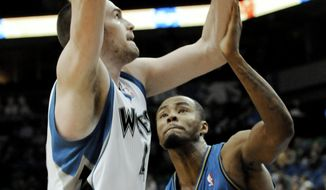 Washington Wizards' Rashard Lewis, right, defends Minnesota Timberwolves' Kevin Love during the first half of an NBA basketball game Thursday, Jan. 13, 2011, in Minneapolis. (AP Photo/Jim Mone)
