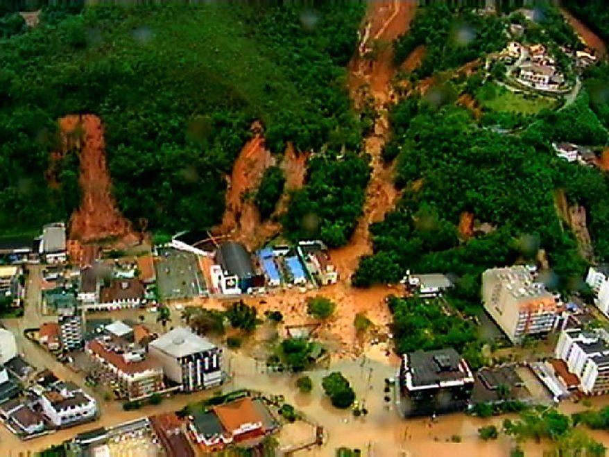 This frame grab from video provides an aerial view of a mudslide in Teresopolis, Brazil, Wednesday Jan. 12, 2011. Torrential rain tore through Rio de Janeiro's mountains, killing hundreds. (AP Photo/TV Globo, Agencia O Globo)