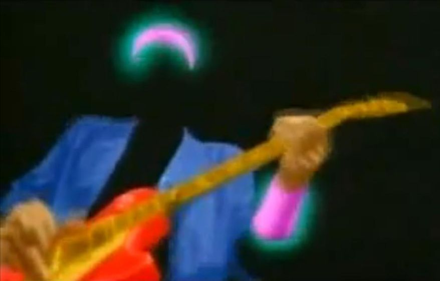 "A still image from the video for Dire Straits' ""Money for Nothing"""
