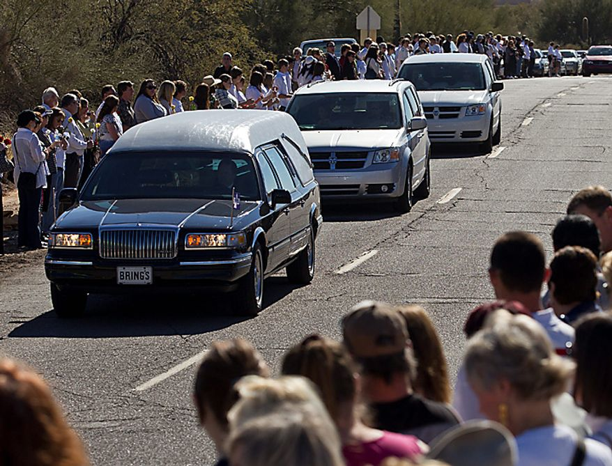 A hearse arrives at the St. Elizabeth Ann Seton Church for the funeral of 9-year-old Christina Green Thursday, Jan. 13, 2011, in Tucson, Ariz. Green was the youngest victim of Saturday's shooting in Tucson. (AP Photo/Chris Carlson)