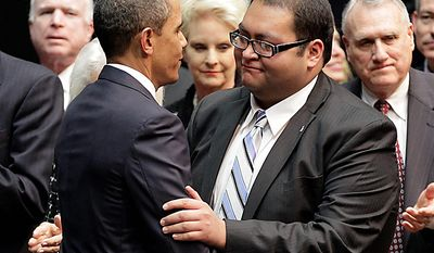 ** FILE ** President Obama greets Daniel Hernandez, an intern for Rep. Gabrielle Giffords, who helped her after she was shot, at a memorial service on the University of Arizona campus in Tucson, Ariz., on Wednesday, Jan. 12, 2011. (AP Photo/J. Scott Applewhite)