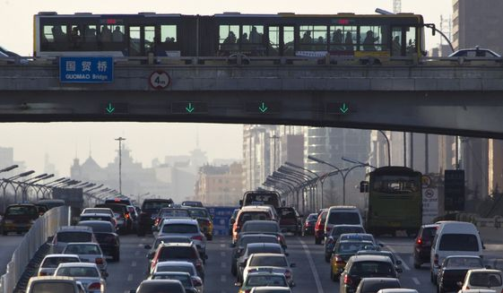 Vehicles pack the main roads during the day in central Beijing, China, on Thursday, Dec. 23, 2010. (AP Photo/Alexander F. Yuan)