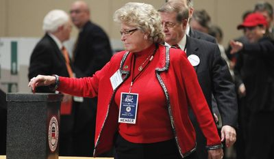 Republican National Committee (RNC) member Borah Van Dormolen from Texas casts her vote for the next chairman of the Republican National Committee during the RNC Winter Meeting at the National Harbor in Oxon Hill, Md., on Friday, Jan. 14, 2011. (AP Photo/Manuel Balce Ceneta)