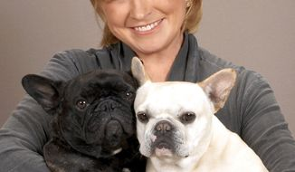 """**FILE** Martha Stewart is pictured with her French Bulldogs Francesca and Sharkey in this photo from Oct. 20, 2009. The 69-year-old lifestyle guru wrote on her blog on Jan. 13, 2011, that she needed stitches after startling her dog Francesca while leaning down to """"whisper goodbye."""" (Associated Press/PRNewsFoto/Martha Stewart Living Omnimedia)"""