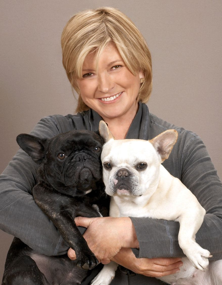 "**FILE** Martha Stewart is pictured with her French Bulldogs Francesca and Sharkey in this photo from Oct. 20, 2009. The 69-year-old lifestyle guru wrote on her blog on Jan. 13, 2011, that she needed stitches after startling her dog Francesca while leaning down to ""whisper goodbye."" (Associated Press/PRNewsFoto/Martha Stewart Living Omnimedia)"