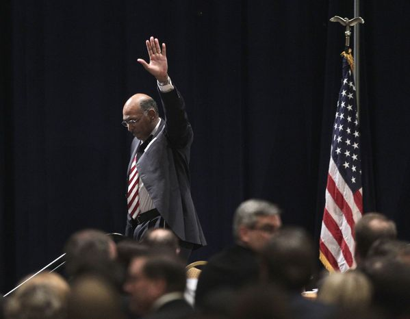 Republican National Committee (RNC) Chairman Michael Steele walks off stage after announcing that he would drop his re-election bid, Friday, Jan. 14, 2011, during the Republican National Committee Winter Meeting in Oxon Hill, Md. (AP Photo/Pablo Martinez Monsivais)