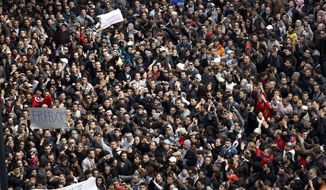 Protesters chant slogans against President Zine El Abidine Ben Aliin during a demonstration in Tunis, Friday, Jan. 14, 2011. (AP Photo/Christophe Ena)