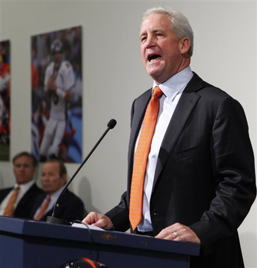 John Fox, the new head football coach of the NFL Denver Broncos football team, speaks at a news conference at the teams headquarters in Englewood, Colo., on Friday, Jan. 14, 2011. John Elway, Executive V.P. of football operations and owner Pat Bowlen look on at left.(AP Photo/ Ed Andrieski)