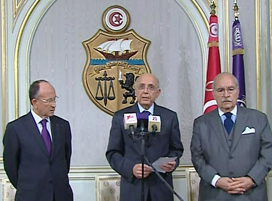 Prime Minister of Tunisia, Mohammed Ghannouchi, centre, appears on state television with other unidentified government members, Friday Jan. 14, 2011,  to announce that he is assuming power in Tunisia. The announcement came on Friday after many thousands of protesters mobbed the capital of Tunis to demand the ousting of President Zine El Abidine Ben Ali, and unconfirmed reports said he has left the country.  Prime Minister Ghannouchi announced on TV that he will hold power until early elections are held. (AP Photo) TV OUT - NO SALES