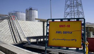 ** FILE ** The exterior of the Arak heavy water production facility in Arak, Iran, 360 kms southwest of Tehran, is seen on in this Oct. 27, 2004, file photo. Seven international envoys are getting a look inside two key Iranian nuclear sites in a tour that Tehran hopes will build support ahead of more talks on its disputed atomic work. The envoys will see the unfinished heavy water reactor near Arak on Saturday, Jan. 15, 2011, and the uranium enrichment facility near Natanz later. (AP Photo/Fars News Agancy)