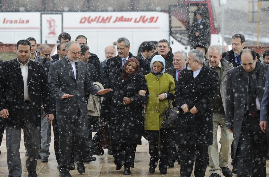 Iran's nuclear chief and acting foreign minister, Ali Akbar Salehi (second from left) gestures as he talks to a group of foreign diplomats through snowfall during their visit to the Iran's heavy water nuclear facilities near the central city of Arak on Saturday. Ali Asghar Soltanieh, Iran's envoy to the U.N.'s International Atomic Energy Agency, walks at second right. (Associated Press/ISNA, Hamid Foroutan)
