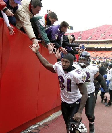 Baltimore Ravens wide receiver Anquan Boldin (81) and defensive tackle Haloti Ngata leave the field after an NFL AFC wild card football playoff game on Sunday, Jan. 9, 2011, in Kansas City, Mo. The Ravens defeated the Kansas City Chiefs 30-7. (AP Photo/Jeff Tuttle)