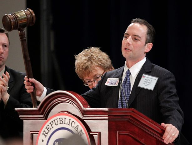 New Republican National Committee Chairman Reince Priebus holds up a gavel after winning the post during the Republican National Committee winter meeting on Friday in Oxon Hill, Md. Mr. Priebus was elected after seven rounds of voting, beating four other candidates, including outgoing chairman Michael S. Steele. (Associated Press)