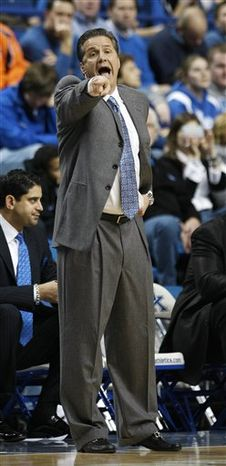 Kentucky coach John Calipari yells to his players during the first half of their NCAA college basketball game against Auburn in Lexington, Ky., Tuesday, Jan. 11, 2011.  (AP Photo/Ed Reinke)
