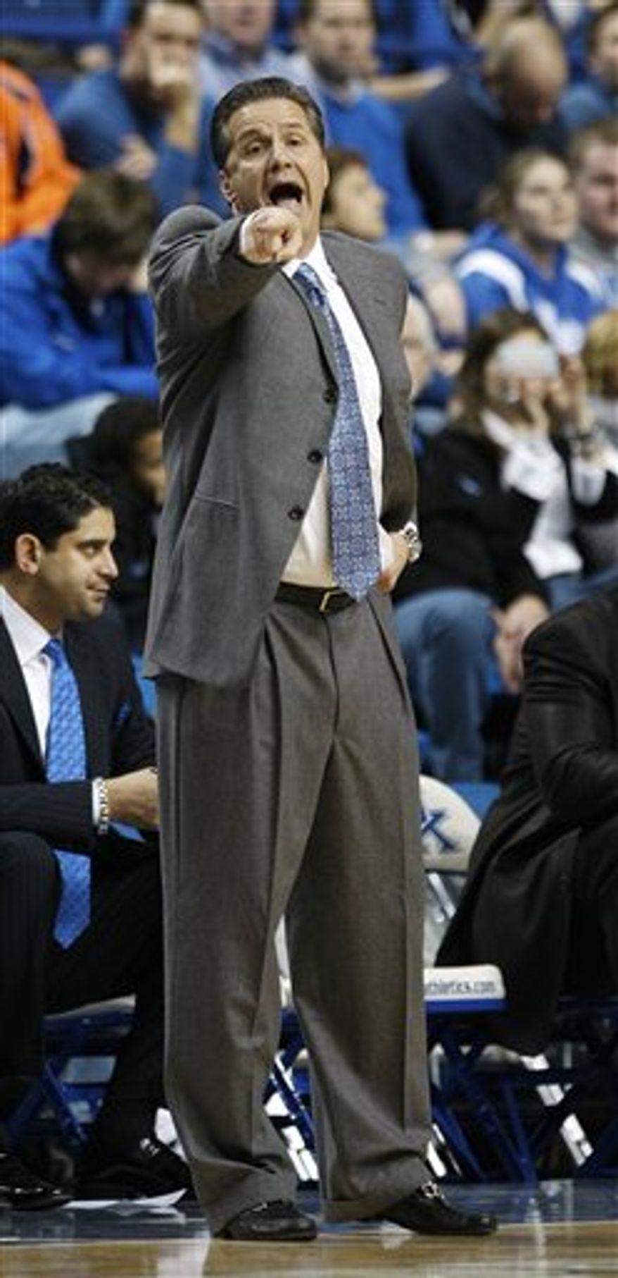 Kentucky coach John Calipari yells to his players during the first half of their NCAA college basketball game against Auburn in Lexington, Ky., Tuesday, Jan. 11, 2011.  (AP Photo/Ed Reinke)