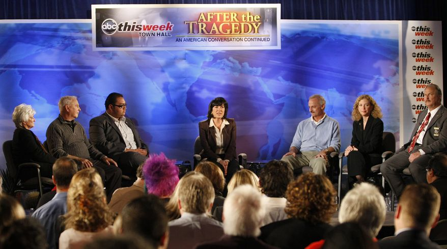"""ABC News correspondent Christiane Amanpour (center) leads a town-hall event at St. Odilia Church in Tucson, Ariz., during a taping of """"This Week"""" on Saturday, Jan. 15, 2011. The event brought together members of the community and residents who were involved in the Jan. 8 shooting in Tucson that claimed the lives of six people and wounded a number of others, including Rep. Gabrielle Giffords. (AP Photo/ABC-TV, Ralph Freso)"""
